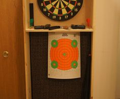 Dartboard stand and airsoft gun